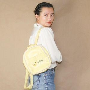 vtg 90s le petit prince mini yellow backpack